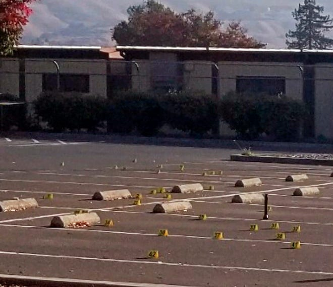 Crime scene evidence markers dot the parking lot of the Searles Elementary School in Union City, Calif.
