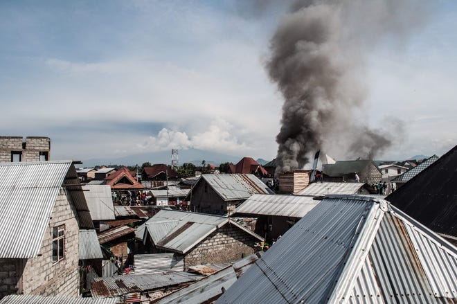 Smoke raises after a small aircraft carrying around 15 passengers crashed in a densely populated area in Goma on the East of the Democratic Republic of Congo on November 24, 2019.