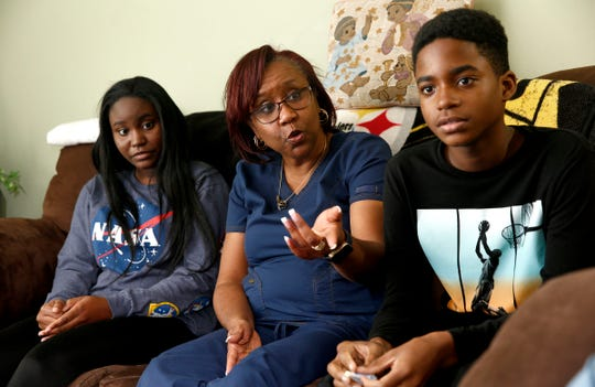 Sonya Middleton is shown in Howell Monday, November 25, 2019 with Yazz, 15, and Eric, 11 - two of the four siblings she recently adopted.