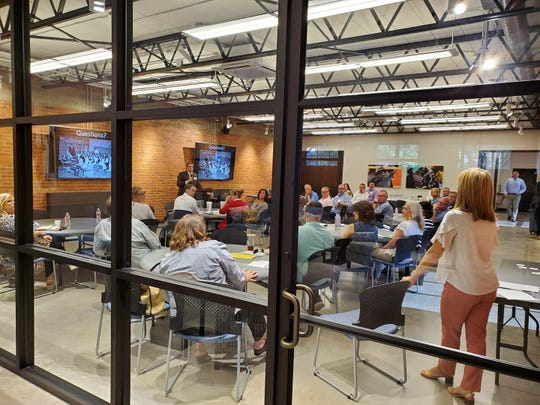 Members of the Big Country Executive Directors Network interact following a conversation with Eddy Smith, executive director of the Abilene Library Consortium and a strategic planning consultant, on strategic planning July 23.