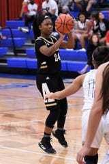 Abilene High's Trakenya Roberson (24) takes a shot against Cooper at Cougar Gym on Monday.