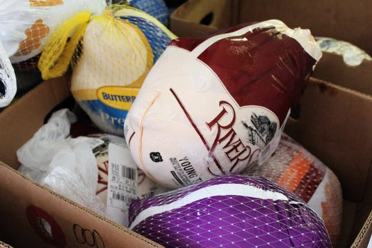 A box of frozen turkeys was the last stop for volunteers taking complete meals to folks in line at First Central Presbyterians's food pantry on Tuesday afternoon.
