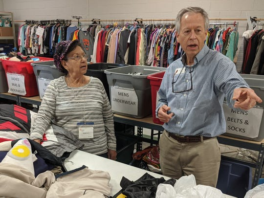 Christian Service Center Executive Director Jim Clark, right, speaks with volunteer Virginia Cortinez about a supply of coats the center recently received during work hours Tuesday. Clark said he has used training through the Community Foundation of Abilene to make Christian Service Center a more efficient nonprofit.