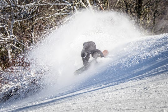 A snowboarder makes some afternoon turns Nov. 25 on the Switchback slope at Sugar Mountain Ski Resort.