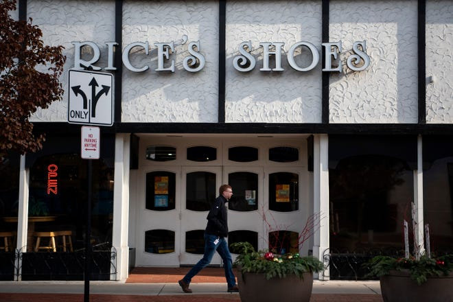 A pedestrian passes by Rice's Shoes on Tuesday, Nov. 26, 2019 in downtown Battle Creek, Mich. Local Battle Creek businesses will be open the day after Black Friday for Shop Small Downtown.