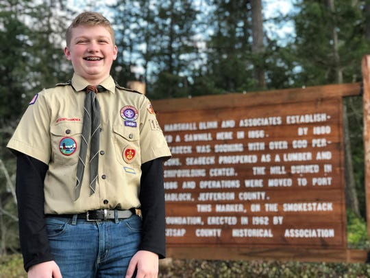 Evan Holmstrom and his fellow scouts refurbished a sign damaged in a storm in Seabeck in 2012. The sign pays tribute to a mill that, in its day, grew a town there that was bigger than Seattle.