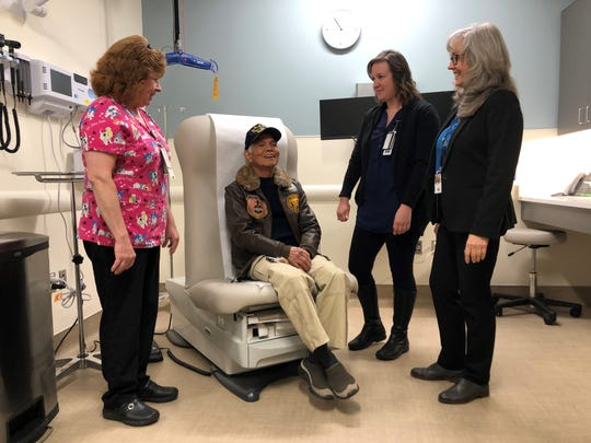 Navy Veteran Roger Mangahas Sr. tests out a new treatment recliner at the grand opening of the VA Clinic off Ridgetop Boulevard in Silverdale. He's surrounded by VA Lab Technician Chris Bronson, left, nurse Patricia Johnston, center and Dr. Kathleen Tonti-Horne, the director of the clinic.