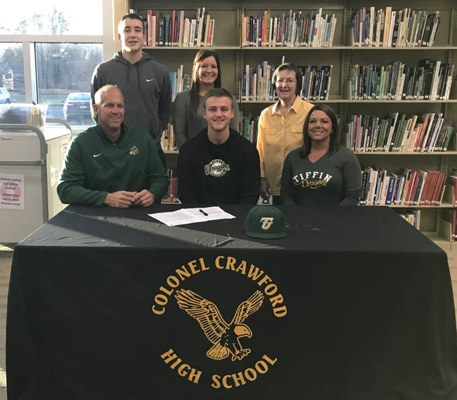 Colonel Crawford's Gavin Feichtner signs his letter of intent to play baseball at Tiffin U.  In the front row are his father and mother, Mike and Julie. In the back, his brother Carson, sister Morgan Mercer and grandmother Ann Miller.