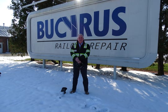 Co-owner Thom Cathcart stands outside Bucyrus Railcar Repair in Bucyrus.