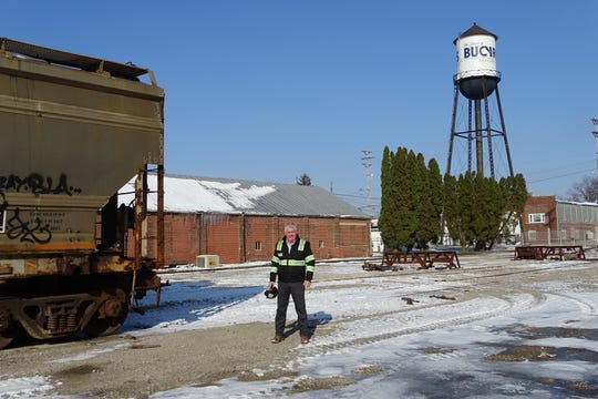 Co-owner Thom Cathcart stands in the yard at Bucyrus Railcar Repair in Bucyrus.