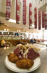 A corned beef special is served with potato latkes at the Kibitz Room restaurant in Cherry Hill.
