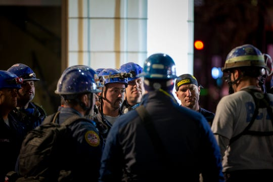 Crews continue the recovery effort at the scene of a partial building collapse at the construction site on W. 4th Street between Race and Elm Streets in downtown Cincinnati on Tuesday, Nov. 26, 2019. Turner Construction announced that four injured workers were released from the hospital late Monday night, but search and rescue crews worked through the night in search of one missing worker.