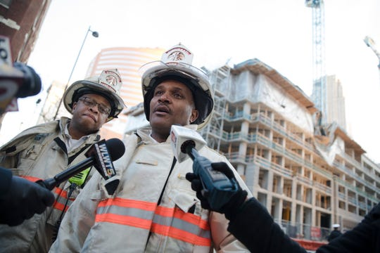 Cincinnati Fire Chief Roy Winston gives an update on the effort to recover a missing worker on Tuesday, Nov. 26, 2019, on the 100 block of West Fourth Street. The building partially collapsed on Monday.