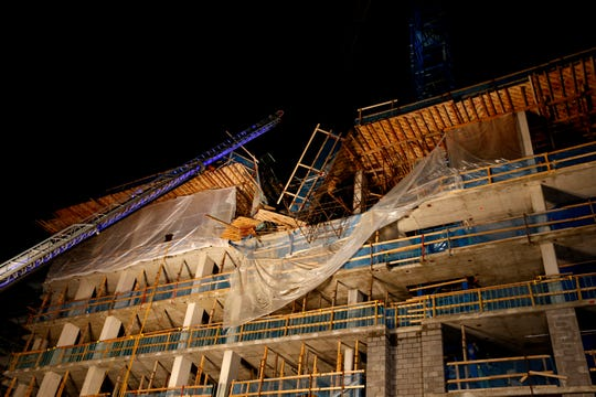 Crews continued to work through the night for a partial building collapse at the construction site on W. 4th Street between Race and Elm in downtown Cincinnati on Monday, Nov. 25, 2019