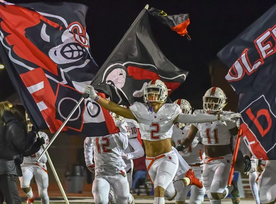 Deshawn Pace of the Colerain Cardinals leads the team onto the field against the Elder Panthers during the OHSAA Region 4 Final on Friday, November 22, 2019 at Atrium Stadium, Mason, Ohio