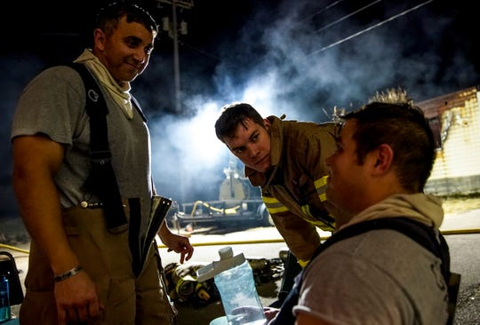 CFD recruits Ariel Morales, left, and Brett Adkins, center, talk with Dustin Winslow, who hadn't felt good nearly all day before Hell Night at Clarksville Fire Rescue in Clarksville, Tenn., on Monday, Nov. 25, 2019.