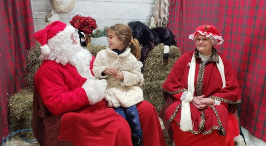 A family enjoys a visit to Santa's Workshop at the Friends of Lord Stirling Stable Winter Holiday Festival, 256 South Maple Ave., Basking Ridge section of Bernards, on Saturday, Dec. 7, and Sunday, Dec. 8.