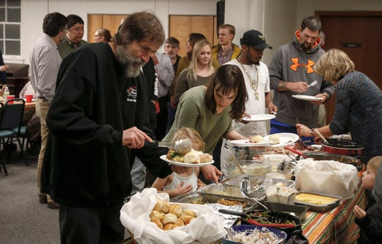 Michael Berkemann of Des Moines places food on his plate during a Thanksgiving dinner for ex-convicts and their families on Nov. 21 at the One Ancient Church in Iowa City. If Kentucky drops its felon voter ban, Iowa would become the only state in the U.S. that bans felons from voting.