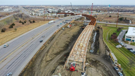 The flyover bridge, linking I-35/80 to Iowa Highway 141, is under construction and is expected to be finished by the end of 2020.