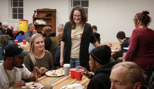 Michelle Heinz, executive director of the Inside Out Reentry program, visits with families during a Thanksgiving dinner for ex-convicts and their families on Nov. 21 at the One Ancient Church in Iowa City. If Kentucky ends its felon voter ban, Iowa would become the only state in the U.S. that bans felons from voting.