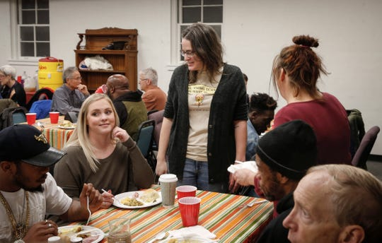 Michelle Heinz, executive director of the Inside Out Reentry program, visits with families during a Thanksgiving dinner for ex-convicts on Thursday, Nov. 21, 2019, at the One Ancient Church in Iowa City. Iowa could become the only state in the U.S. that bans felons from voting.