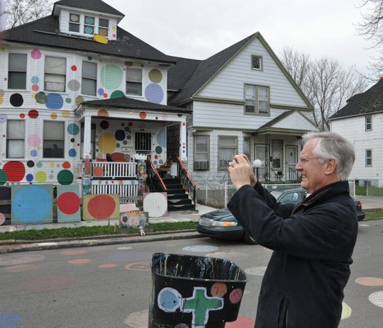 Valentino Castellani, the former mayor of Turin, Italy, snaps photos of Detroit's picturesque Heidelberg Project on Thursday, April 14, 2011. Castellani was one of several dozen urban experts from the United States and Europe who took part in the American Assembly conference in Detroit on revitalizing older industrial cities. Picture shot on Heidleburg Street on the east side of Detroit on March 14, 2011. John Gallagher/Detroit Free Press