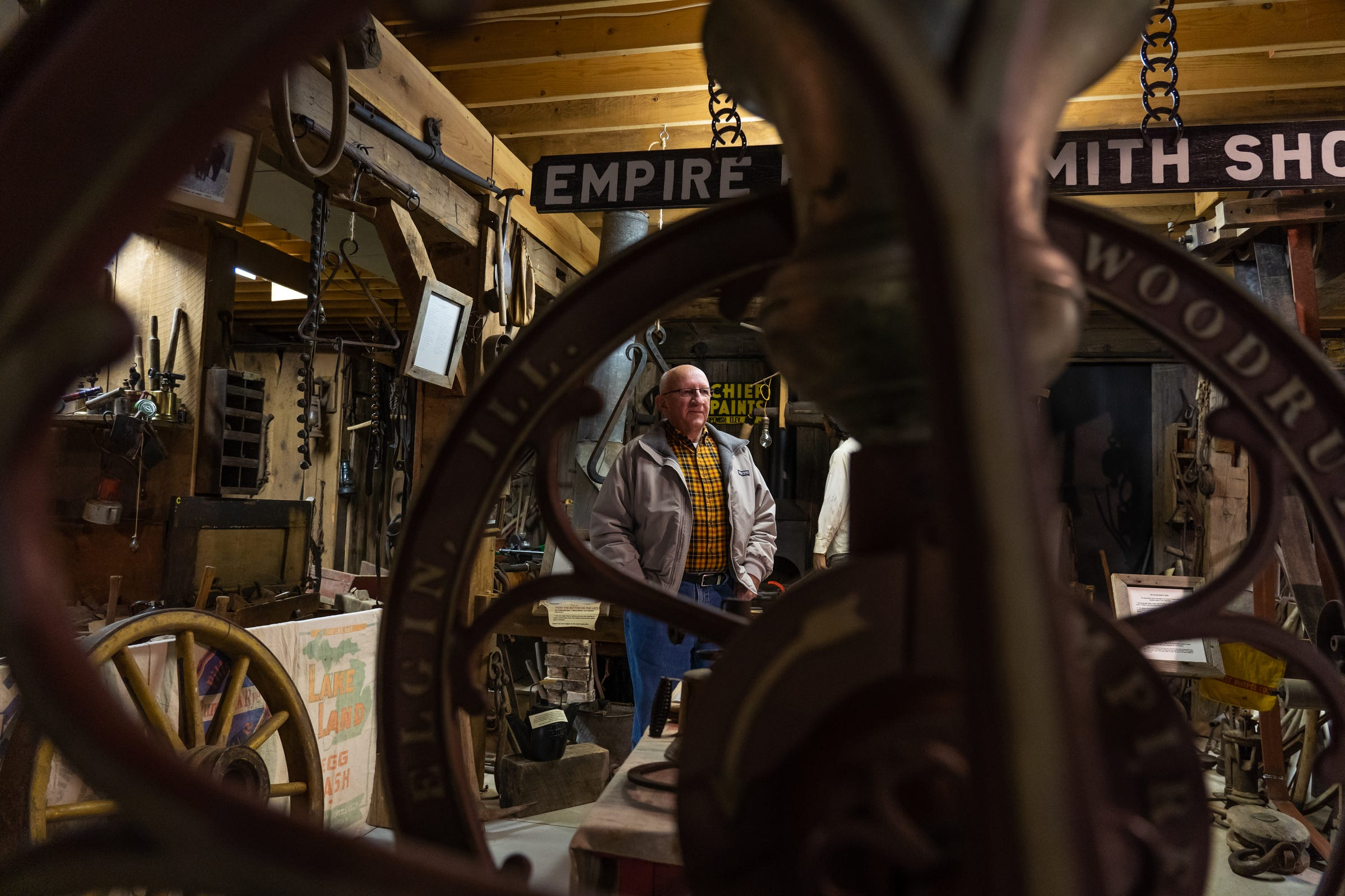 """Empire Area Heritage Group President Dave Taghon stands inside the village's historical museum on Wednesday, Nov. 8, 2019. """"To me, I think it's important to save our history, to know where you've been, and then decide maybe your path forward,"""" he said."""