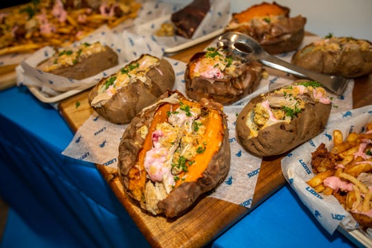 Potatoes loaded with turkey and stuffing at Ford Field for Thanksgiving.