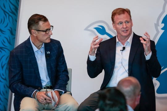 Dan Miller, left, listens as NFL commissioner Roger Goodell answers a question during the Detroit Lions Fan Forum at Ford Field in Detroit, Aug. 22, 2017.