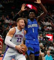 Detroit Pistons forward Blake Griffin (23) attempts a layup as Orlando Magic forward Jonathan Isaac (1) defends during the first half of an NBA basketball game, Monday, Nov. 25, 2019, in Detroit. (AP Photo/Carlos Osorio)