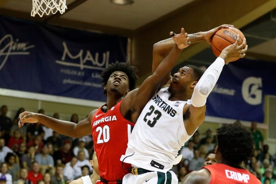 Georgia's Rayshaun Hammonds tries to stop Michigan State's Xavier Tillman during the first half Tuesday in Lahaina, Hawaii.