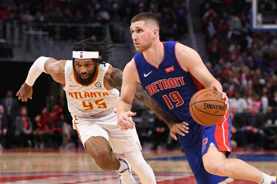 Detroit Pistons guard Svi Mykhailiuk drives to the basket against Atlanta Hawks guard DeAndre' Bembry at Little Caesars Arena, Nov. 22, 2019.