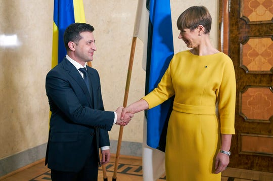 In this photo provided by the Ukrainian Presidential Press Office, President of Estonia Kersti Kaljulaid, right, welcomes Ukrainian President Volodymyr Zelenskiy during their meeting in Tallinn, Estonia, Tuesday, Nov. 26, 2019.