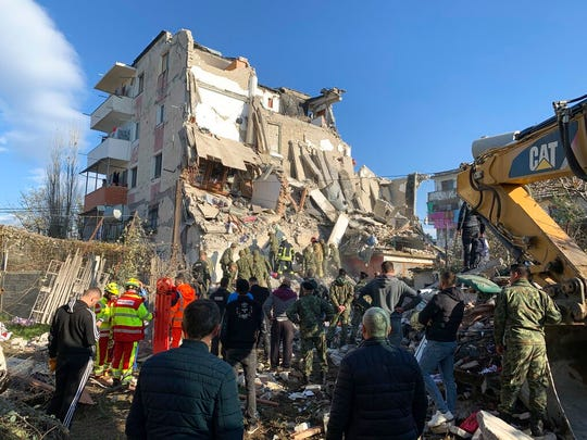 Rescue crews used excavators to search for survivors trapped in toppled apartment buildings after a powerful pre-dawn earthquake in Albania killed at least six people and injured more than 300.