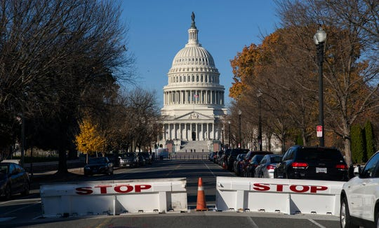 Barricades are raised on East Capitol Street as the U.S. Capitol and its office buildings were briefly evacuated amid concerns about a small aircraft in the area, in Washington, Tuesday, Nov. 26, 2019.