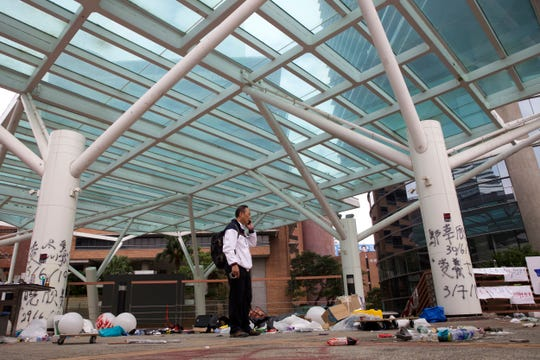 Professor Alex Wai, Vice President of the Polytechnic University, takes in the vandalized campus as he leads a team of school officials and first aid providers to look for holed up protesters on a roof top of the campus in Hong Kong.