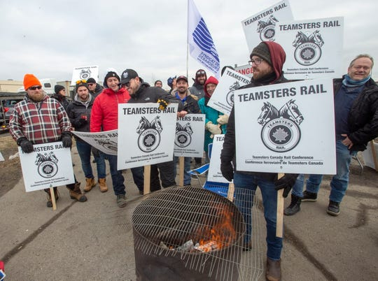 Striking Canadian National Railway workers picket in front of the company's Taschereau railyard Monday, November 25, 2019 in Montreal.