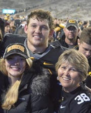 Kelsey, T.J. and Teri Hockenson after an Iowa football game.