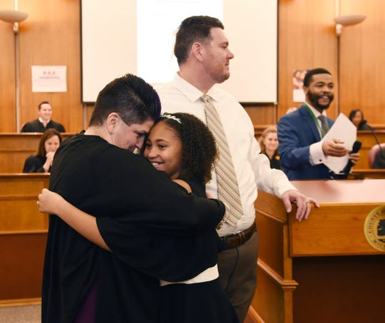 Amari Ann Patterson hugs her adopted mom, Jennifer Patterson of Rochester Hills, after the 17th annual Oakland County Adoption Day event in Pontiac.