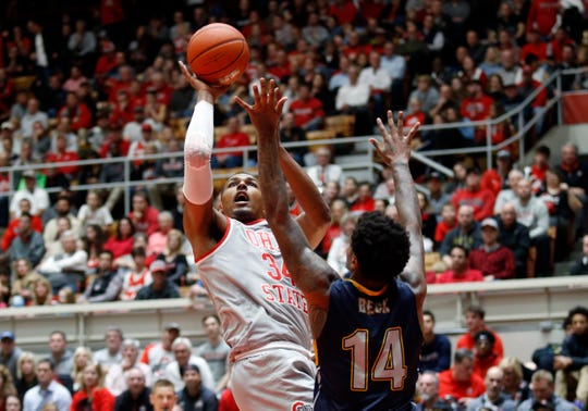 Ohio State forward Kaleb Wesson, left, goes up to shoot in front of Kent State forward Tervell Beck on Monday.