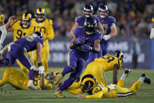 Baltimore Ravens running back Mark Ingram runs against the Los Angeles Rams during the second half Monday.