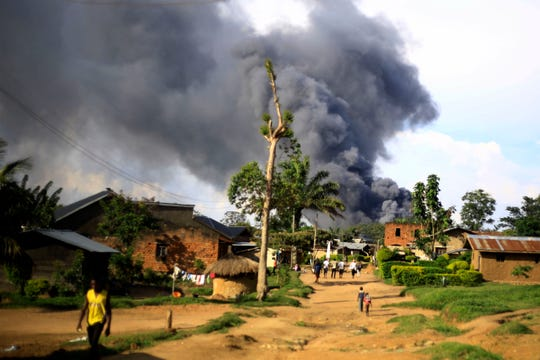 Smoke from the United Nations compound rises in Beni, Democratic Republic of Congo on Monday.