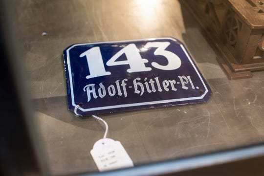 A street sign for 143 Adolf Hitler Place is displayed for an auction Nov. 20 at the Hermann Historica auction house in Grasbrunn near Munich, Germany.