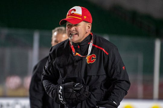 The NHL said Tuesday it is investigating allegations Calgary Flames coach Bill Peters directed racial slurs toward Akim Aliu when he and the Nigerian-born player were in the minors a decade ago.