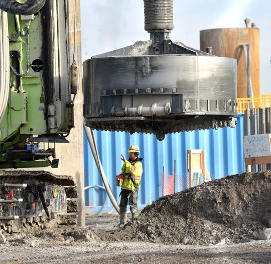 An auger used to drill through solid rock is pulled out of the shaft at the construction site in Windsor, Ontario, for the Gordie Howe bridge Tuesday.