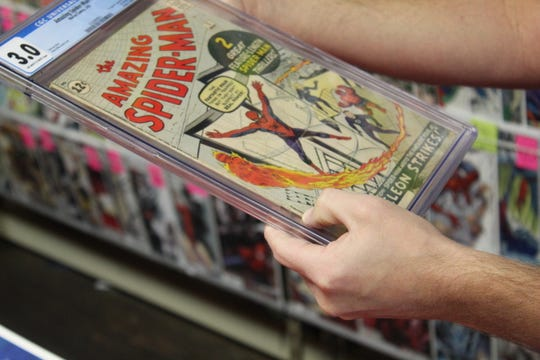 "Chris Rupp, owner of Rupp's Comics shows ""The Amazing Spider-man #1"" he is selling for $8,500."