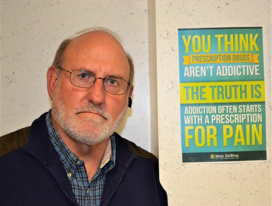 After losing his son, Joey, to a drug overdose three years ago, Dr. Paul Silcox has worked to educate the public on the realities of addiction. He has hung many signs like the one here in his Fremont chiropractic office.