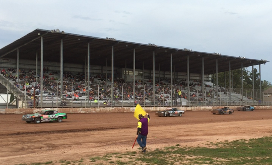 Stock cars make laps under a caution flag at Luxemburg Speedway. The dirt track on the Kewaunee County Fairgrounds is seeking a promoter for its 2020 racing season.