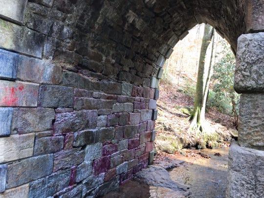 Spray paint coats the a wall of South Carolina's oldest bridge.