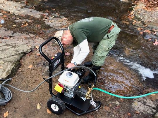 Brian Long prepares a power washer at Poinsett Bridge.